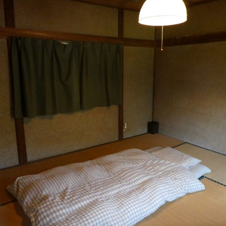 bed room with Futon at BAKKE Ottobatake House